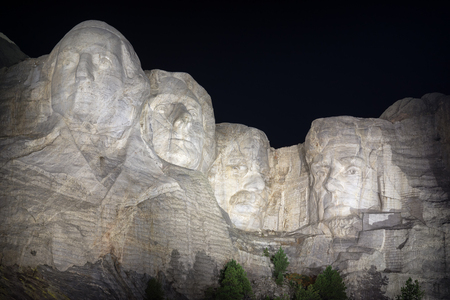 Mount Rushmore at night with all four presidents visible in South Dakota Editorial