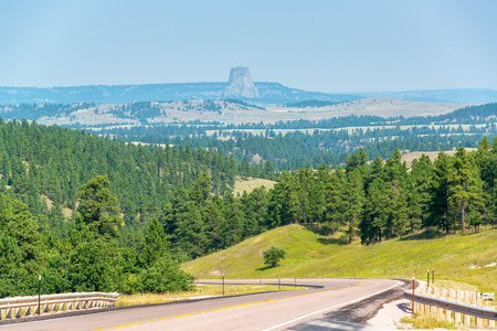 wyoming: Highway in Wyoming with Devils Tower National Monument visible in the background