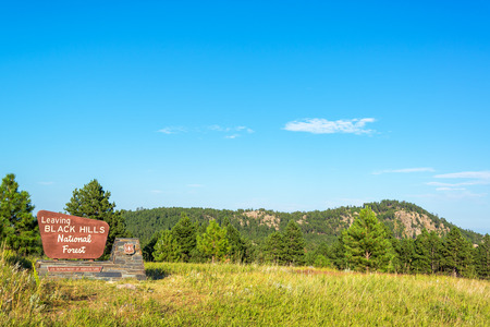 black forest: Sign marking the boundary of the Black Hills National Forest Stock Photo