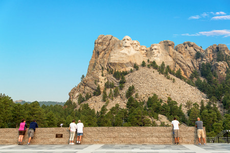 abe: KEYSTONE, SD - AUGUST 28: Tourists at Mount Rushmore National Memorial on August 28, 2015 near Keystone, SD
