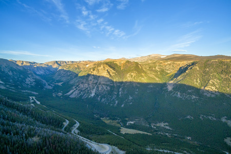 switchback: Aerial view of the Beartooth Mountains with a switchback road visible below Stock Photo
