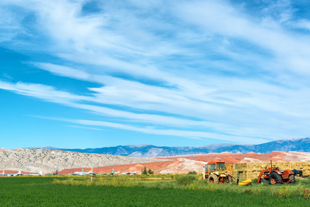 agricultural implements: Landscape featuring tractors and an airplane boneyard in Greybull, Wyoming