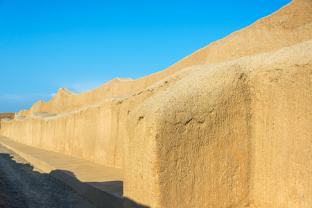 adobe wall: Large adobe wall in the ruins of Chan Chan in Trujillo, Peru
