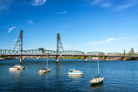 hawthorne: Four boats in front of the Hawthorne Bridge in Portland, Oregon