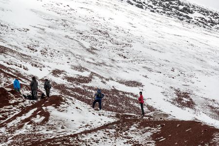 december 21: COTOPAXI, ECUADOR - DECEMBER 21: Tourists standing on Cotopaxi Volcano in Ecuador on December 21, 2014 Editorial