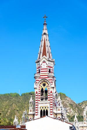 carmen: Beautiful stripe spire of El Carmen church in La Candelaria neighborhood in Bogota, Colombia