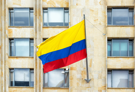 colombian flag: Colombian flag waving in the wind in downtown Bogota, Colombia