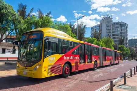 BOGOTA, COLOMBIA - APRIL 21: Transmilenio bus passes through downtown Bogota, Colombia on April 21, 2016 Editorial