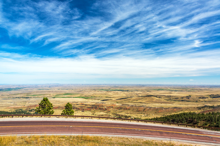 View of a highway with a beautiful landscape and dramatic sky near Sheridan, Wyoming