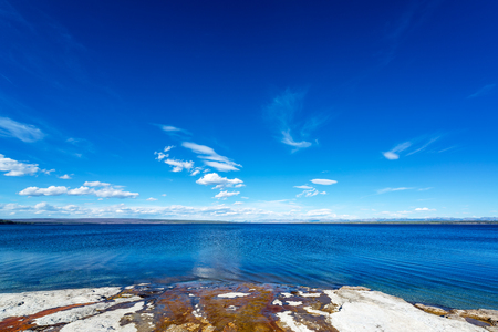 Water from natural pools running into Yellowstone Lake at West Thumb Geyser Basin in Yellowstone National Park Stock Photo