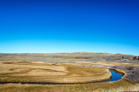curving: Small stream curving through Yellowstone National Park Stock Photo
