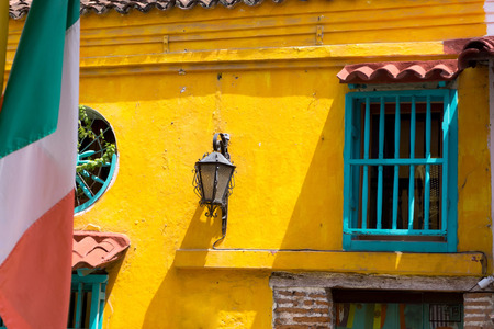 italian architecture: Colorful colonial architecture in Cartagena, Colombia with an Italian flag in the foreground