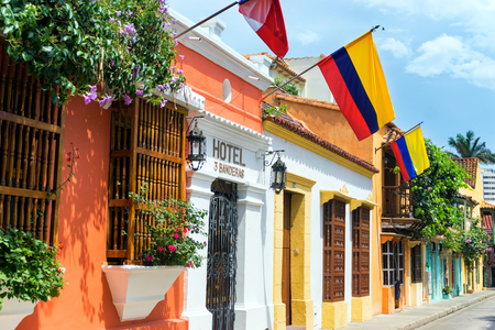 CARTAGENA, COLOMBIA - MAY 23: Row of Colombian flags hanging over colonial architecture in Cartagena, Colombia on May 23, 2016