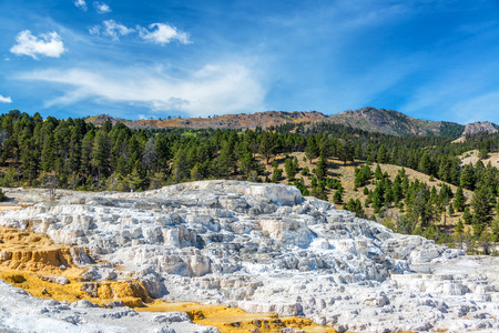White travertine terraces and beautiful landscape at Mammoth Hot Springs in Yellowstone National Park Stock Photo