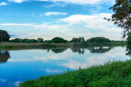 magdalena: View of the Magdalena River with a beautiful reflection in Mompox, Colombia Stock Photo