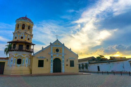 exterior shape: Beautiful Santa Barbara church with a dramatic sky at sunset in Mompox, Colombia