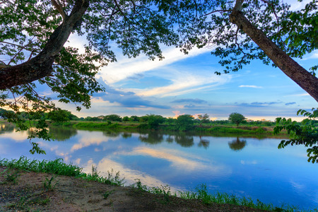 Beautiful view of the Magdalena River framed by trees in Mompox, Colombia Stock Photo