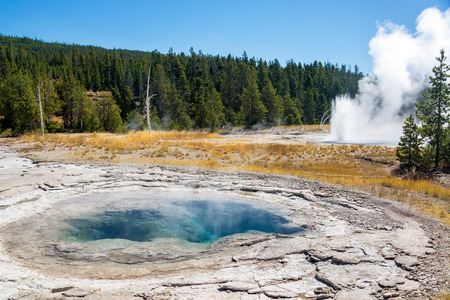 View of the Spa Geyser in the Upper Geyser Basin in Yellowstone National Park Stock Photo