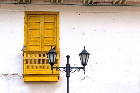 colonial building: Street lights and pigeons in front of a colonial building in Salento, Colombia