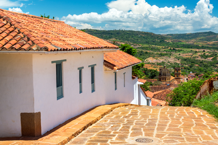 santander: View of colonial town of Barichara, Colombia with the cathedral visible in the distance Stock Photo