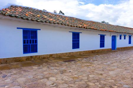 colonial building: White colonial building with blue windows in Villa de Leyva, Colombia