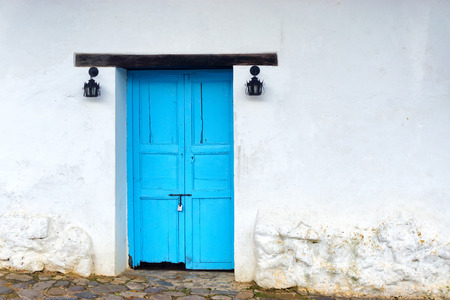 colonial building: View of old wooden door on white colonial building in Villa de Leyva, Colombia Stock Photo