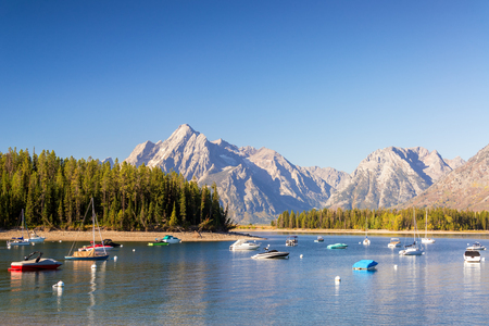 port jackson: Boats in Colter Bay with the Teton Mountain Range in the background in Ground Teton National Park