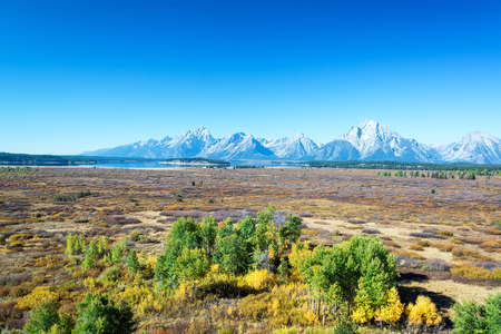 Flat field with the Teton Range rising above it in Grand Teton National Park