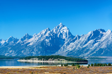 oxbow: Teton Range with a tree covered island in the middle of Jackson Lake in Grand Teton National Park