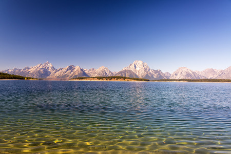 Ripples in Jackson Lake with the Teton Range in the background in Grand Teton National Park
