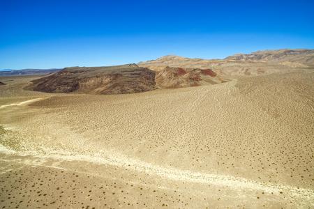 near death: Barren aerial landscape of a stunning desert near Death Valley National Park in California