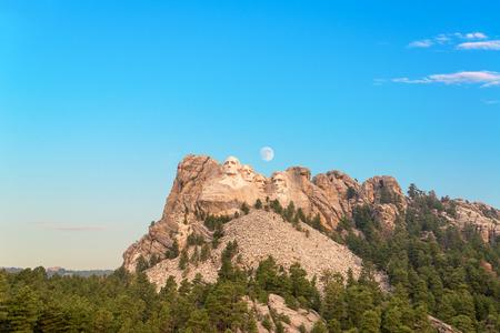 mt rushmore: Mount Rushmore with the moon visible near Keystone, South Dakota Stock Photo