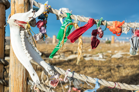 Jawbone and colorful cloth at Medicine Wheel National Historic Landmark in Wyoming Stock Photo