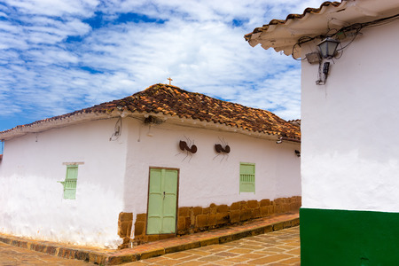 colonial building: Colonial building on a street corner with large ants on the wall in Barichara, Colombia