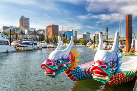 Dragon boats on the Willamette River with downtown Portland, Oregon in the background Stok Fotoğraf