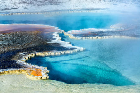 Beautiful clear blue pool in the Upper Geyser Basin in Yellowstone National Park