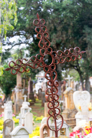 Old rusty cross in the cemetery of Barichara, Colombia