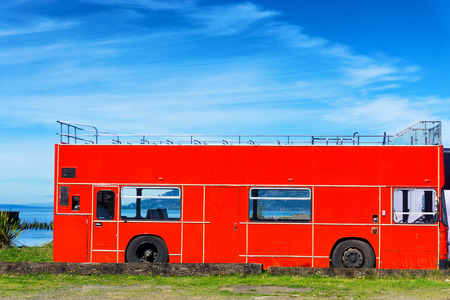 water bus: View of an old red bus in Astoria, Oregon