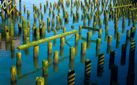 Remains of old piers in the Columbia River in Astoria, Oregon Stock Photo