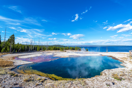 Wide angle view of the Abyss Pool in the West Thumb Geyser Basin in Yellowstone National Park