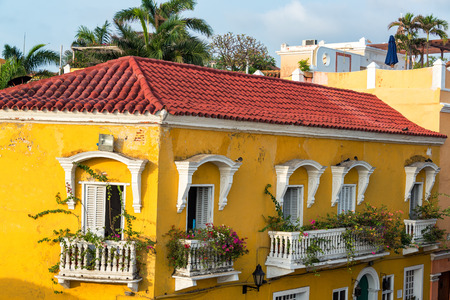 colonial building: Historic yellow colonial building with bougainvillea flowers on the balconies in Cartagena, Colombia