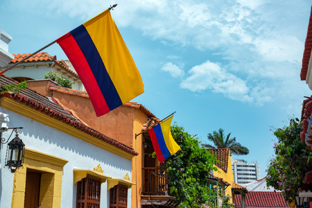 Colombian flags on a row of colonial buildings in the historic center of Cartagena, Colombia