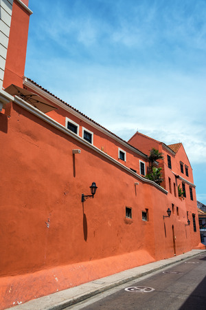colonial building: View of a red historic colonial building the historic walled city of Cartagena, Colombia