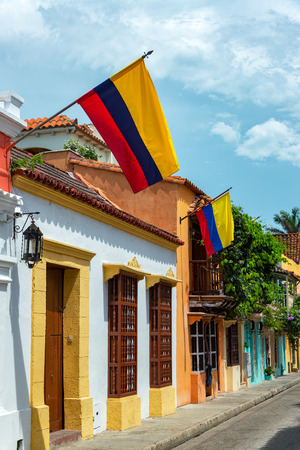 Colombian flags on historic colonial buildings in the walled city of Cartagena, Colombia