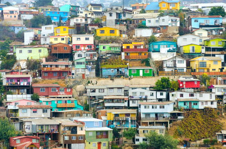 tumble down: Brightly-colored houses tumble merrily down the sheer hills of Valparaiso, Chile Stock Photo