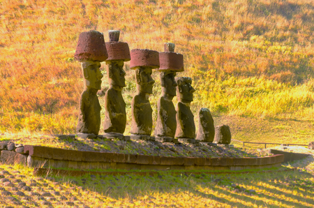 Moai statues wear Pukaos at Anakena Beach on Easter Island in Chile Stock Photo - 69622803