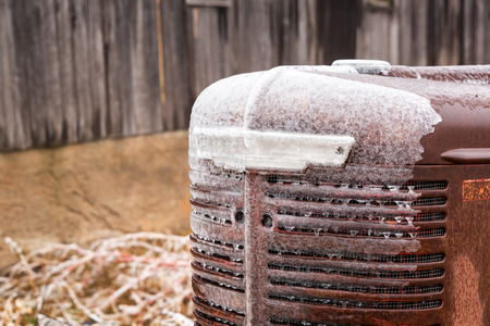 Closeup of an ice covered tractor after a winter storm near Burrton, Kansas