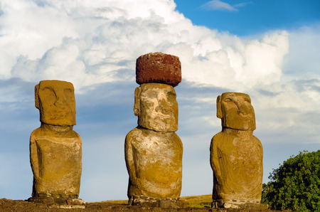 View of three Moai with dramatic clouds on Easter Island in Chile