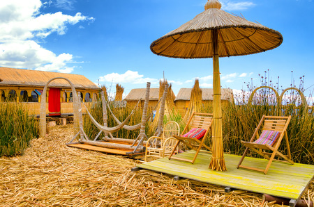 Chairs and hammocks on a man made floating island on Lake Titicaca in Peru Stock Photo & Chairs And Hammocks On A Man Made Floating Island On Lake Titicaca ...