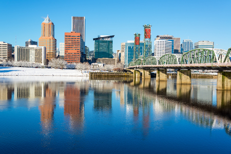 Downtown Portland, Oregon beautifully reflected in the Willamette River with the Hawthorne Bridge Stock Photo